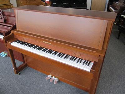 Baldwin model B-47 studio upright piano with American walnut finish