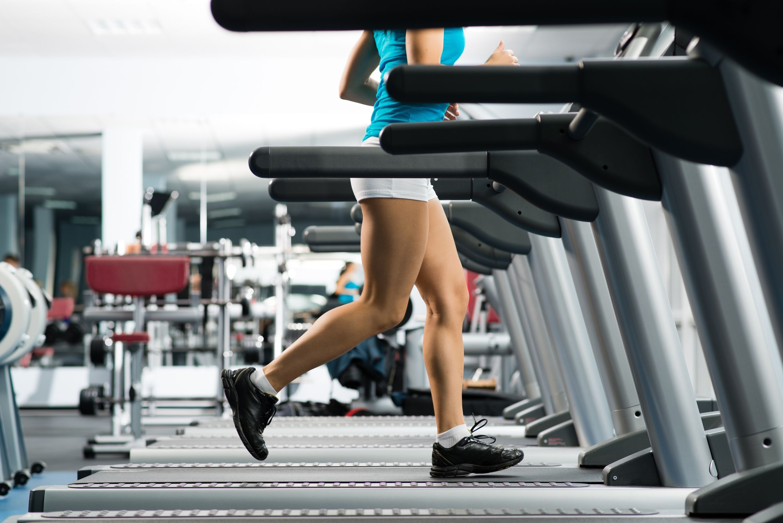 17155279 - woman running on a treadmill in a fitness club, sport in the fitness club