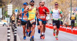 men running marathon approaching finish