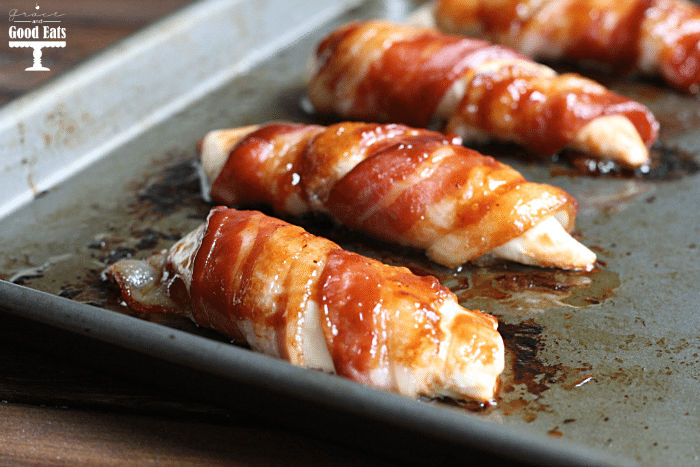 bacon wrapped chicken on a baking sheet