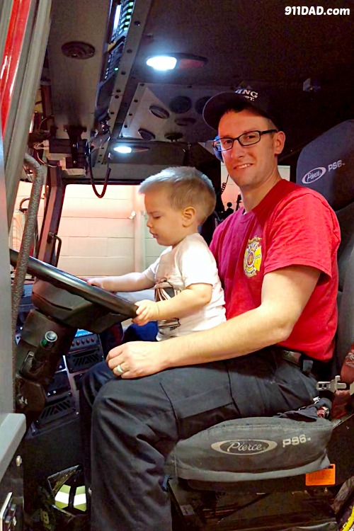 father and son in a fire engine