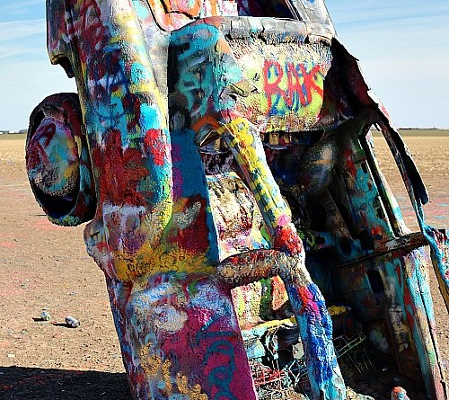 We stopped at Cadillac Ranch during our recent Spring Break trip to the Panhandle and the kids loved it.  Cadillac Ranch is a public art installation and sculpture in Amarillo, Texas featuring ten Cadillac cars half-buried nose-first at an angle in the ground.
