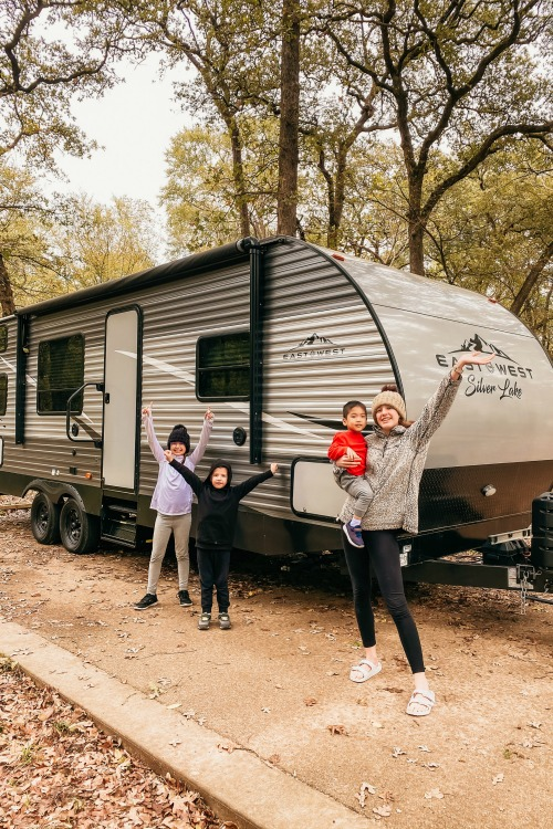 kids standing in front of an RV