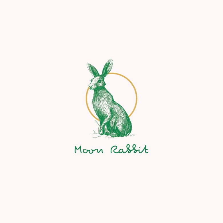 Script font logo with rabbit illustration