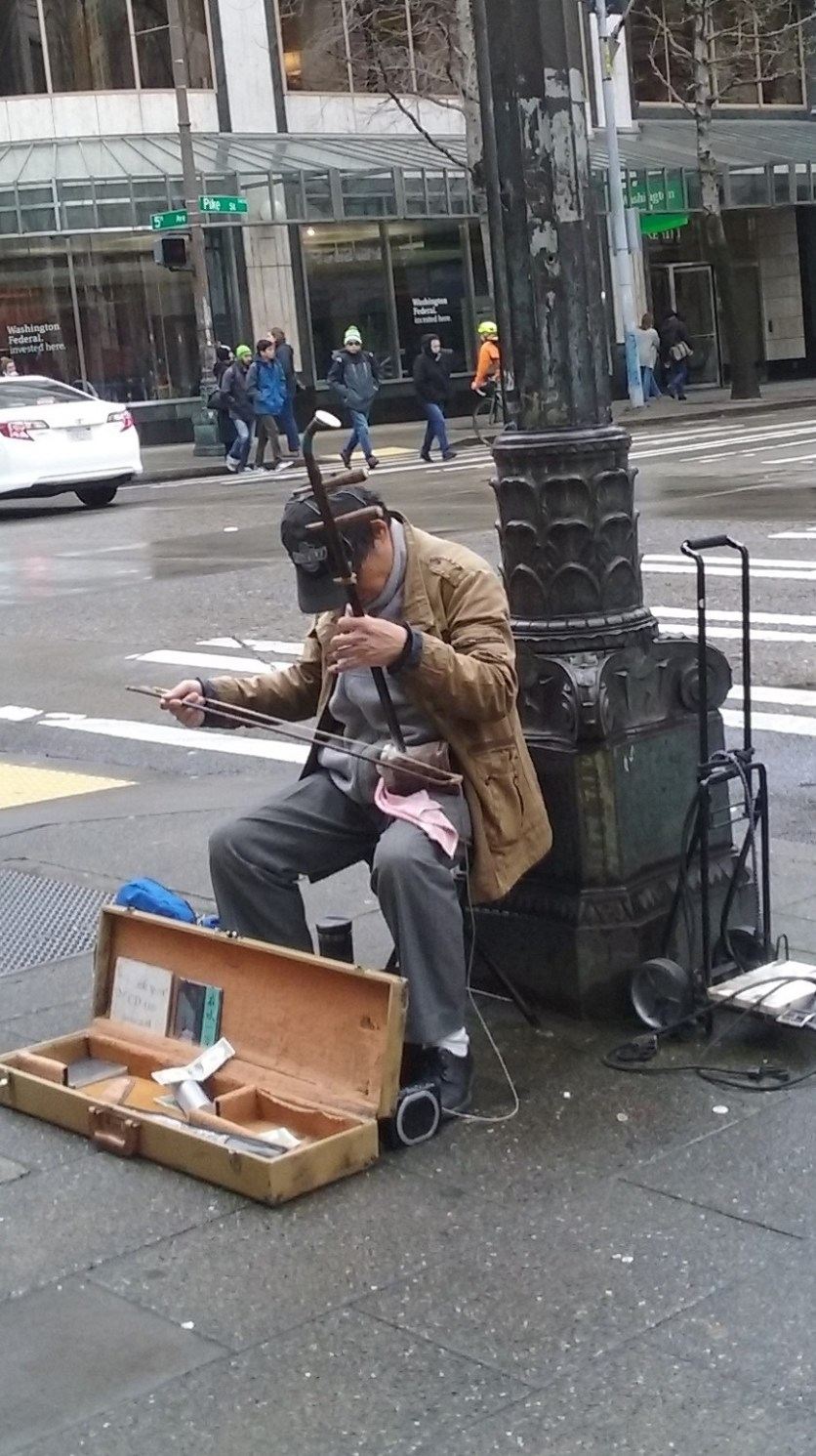 Man playing an erhu, downtown Seattle.