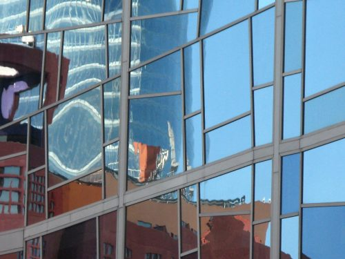 distorted building reflections in window panes