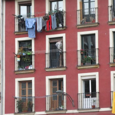 red painted building - balconies and washing