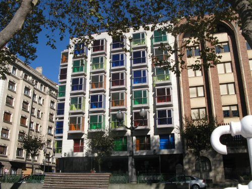 building with coloured glass balconies