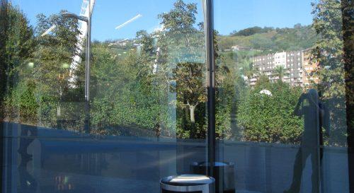 hillside reflected back from window