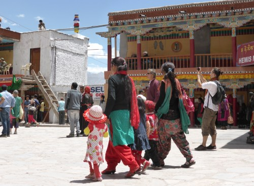 young women and children walking through festival