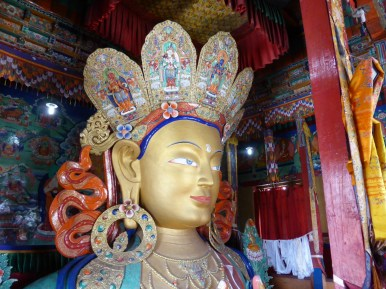 carved and painted deity