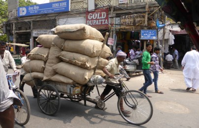 sacks piled up on delivery bike cart