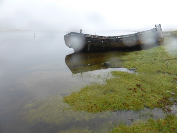 boat and saltmarsh in rain