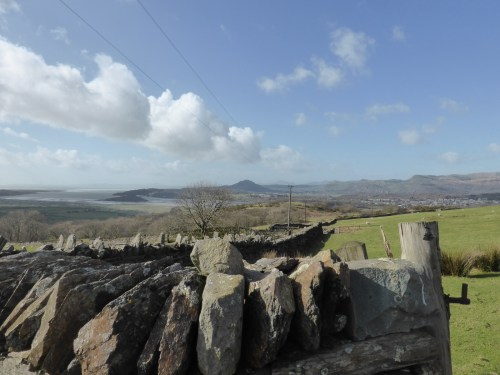 long view across estuary over stone wall