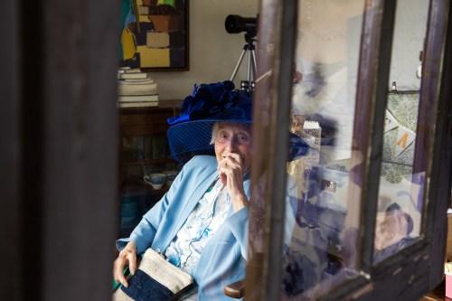 Pat smiling through window