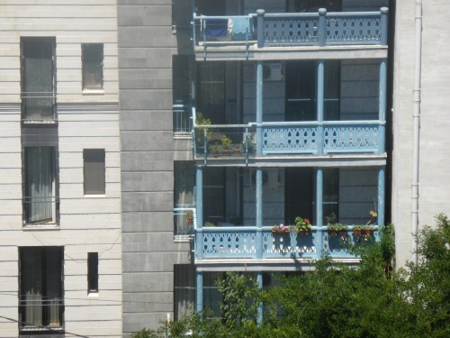 blue-painted balconies