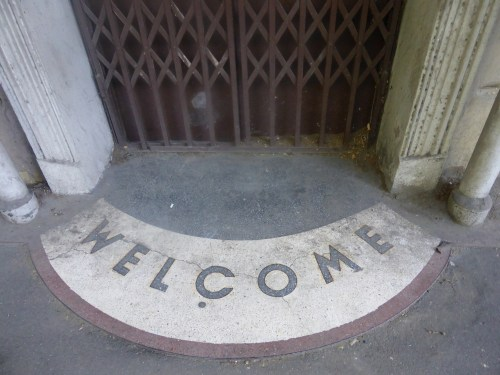 mosaic welcome sign in doorway