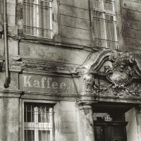 Kaffee hand-painted sign and ornate door lintel