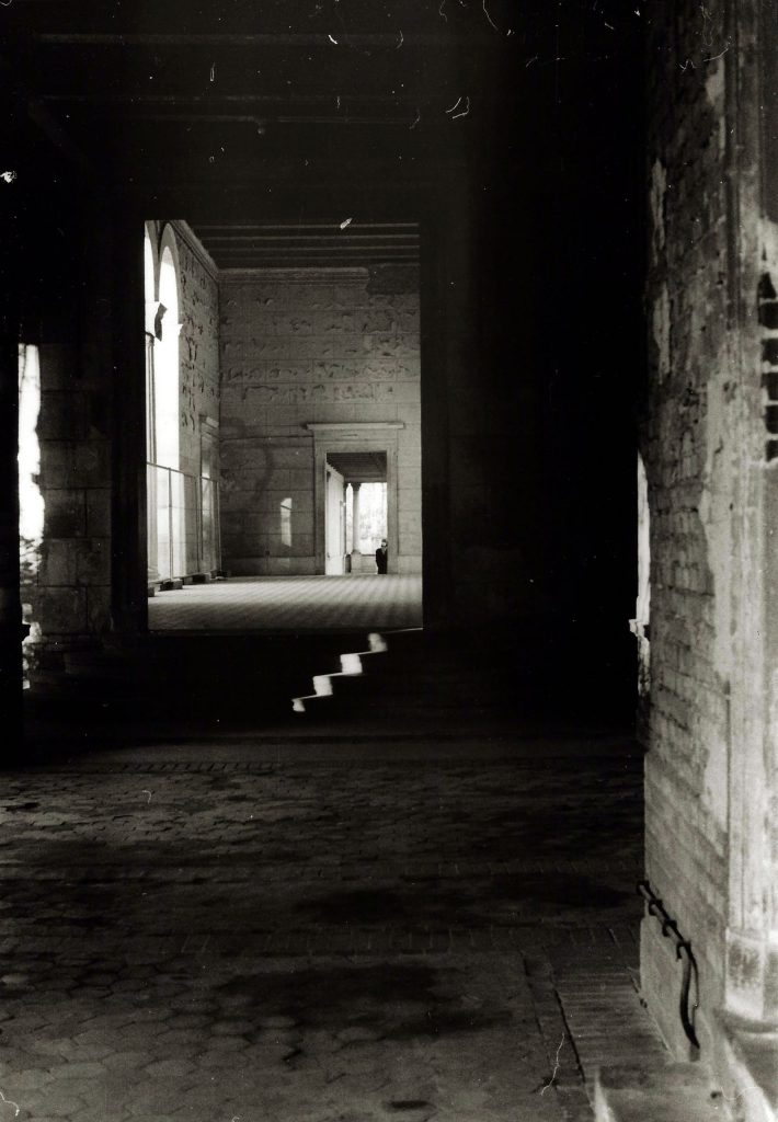sunlight picks out steps inside dark building