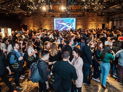 party scene at 99U Conference 2019 with interactive design on the large screen