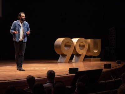 Michael Ventura speaking on the 99U main stage