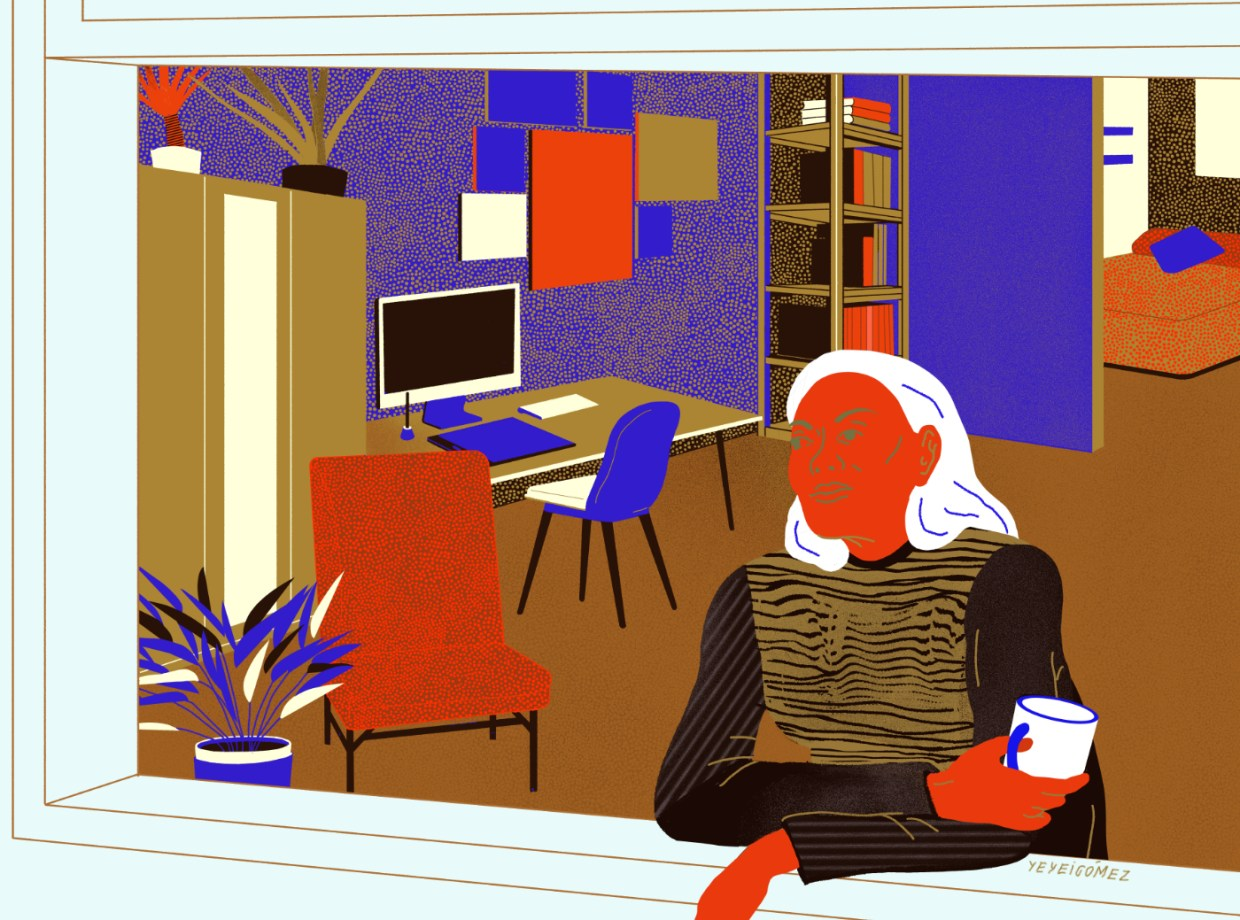 Woman at window at her home office