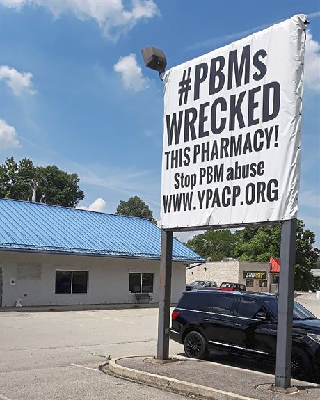 Sign outside a closed pharmacy on Route 422 in Indiana County blames pharmacy business managers for running it out of business.