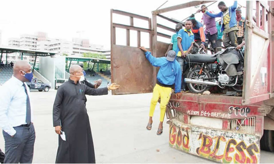 29 Commercial Motorcyclists Traveling To Lagos Caught Inside Truck In Abuja (Photo) 2