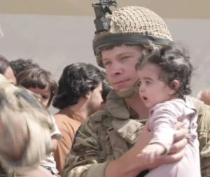 Afghan Mums Throw Their Babies Over Barbed Wire Fences, Beg British Soldiers to Take Them to Safety (Photos)