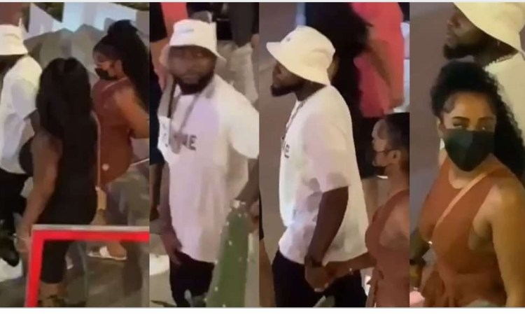 Davido steps out with a mystery woman as he vacations with his crew in St. Maarten. (video)