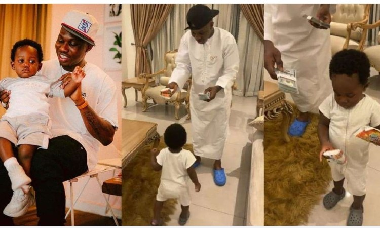 """""""If na girl na otherwise"""" – Singer, Zlatan Ibile disappointed as his son picks snacks over dollar bills (video)"""
