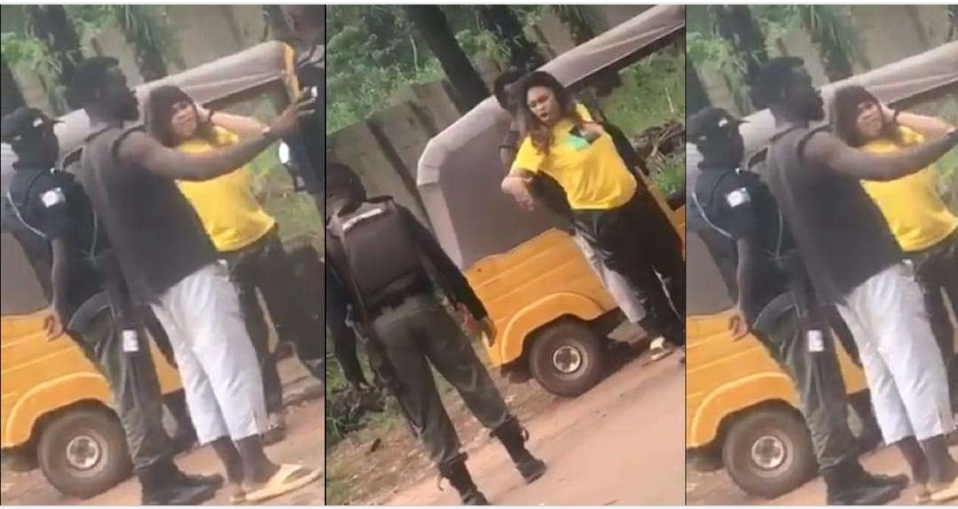 Police Officer caught on camera assaulting woman and calling her 'ashawo' in Enugu (video)
