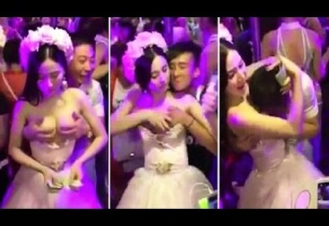 Bride lets guests pull down dress and grope her breasts to raise money for honeymoon (Video)