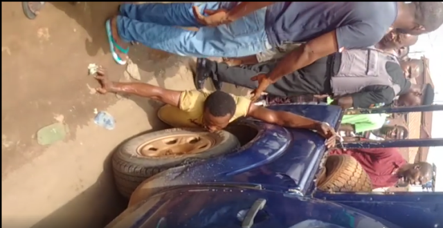 Pictures and Video – Police in Edo chain man to Hilux, drag him along the around