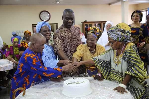 Senator Ike Ekweremadu cutting his 56th birthday cake during his visit at the old peoples home in Enugu