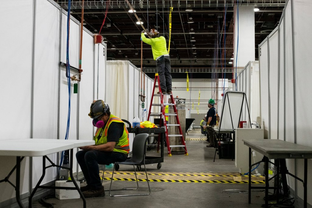 The TCF convention center in Detroit is being transformed into a field hospital.Credit...