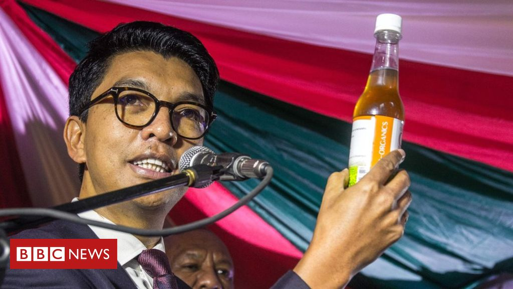 President Andry Rajoelina displaying Madagascar Corona virus Herbal Mixture
