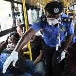 Nigerian Security Agents Doing Covid-19 Guideline Inspection in a crowded bus