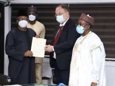L-R The HMH Dr. Osagie Ehanire, His Excellency Alexey Shebarshin and permanent Secretary A. M Abdullah while presenting his document.