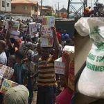 Hungry Nigerians Loot Palliatives in Government Warehouses