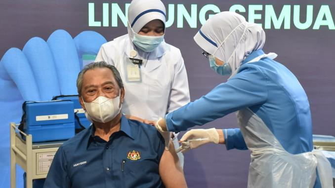 Malaysian PM Muhyiddin receives COVID-19 jab as vaccine roll-out begins in the country