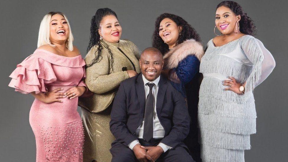 "image captionReality TV personality and polygamist Musa Mseleku (C) sees polyandry as ""unAfrican"""
