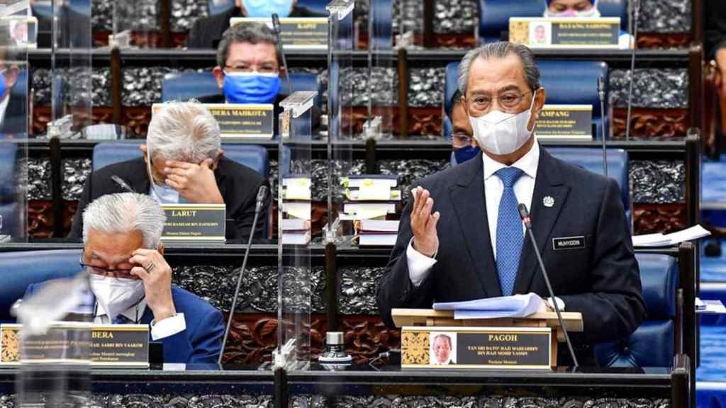Malaysia's Ex- Prime Minister Muhyiddin Yassin speaks in parliament on July 26 after the legislature reopened, following a seven-month hiatus. © Malaysia's Department of Information via AP