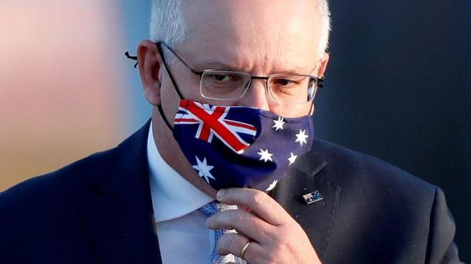 Australian Prime Minister Scott Morrison wearing Australian Flag Mask