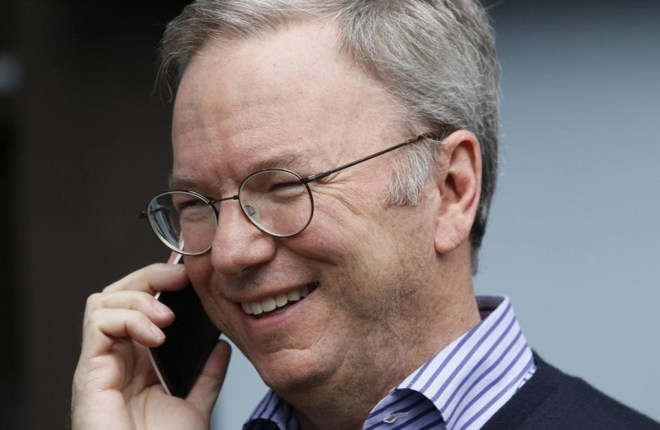 Eric Schmidt, executive chairman of Google, talks on the new yet to be released Google produced Moto X phone at the annual Allen and Co. conference in Sun Valley