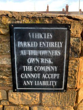 iPhone XR - Car park sign