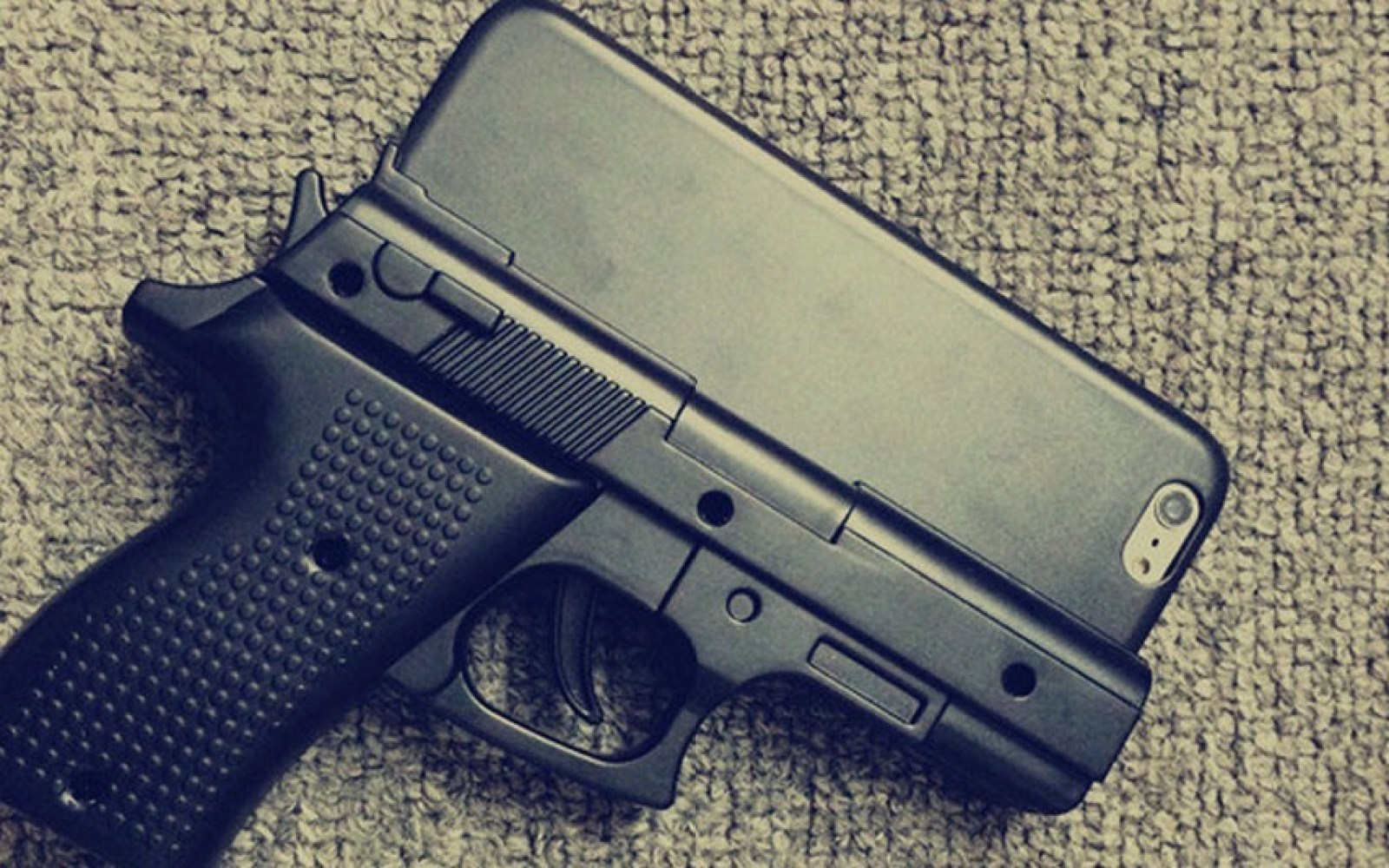 Officials, common sense warn against the use of gun-shaped iPhone cases