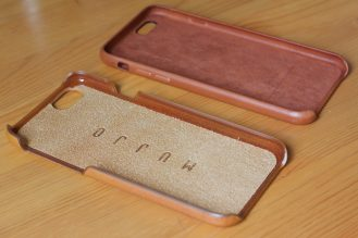 Mujjo Leather Case's suede interior next to a new Apple Leather Case in Saddle Brown
