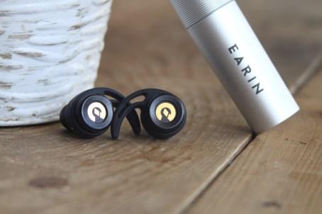 Earin true wireless earbud capsule alongside plant zoomed in