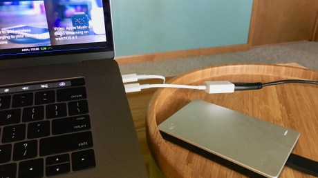 White Apple USB-C power cable and USB-C adapter